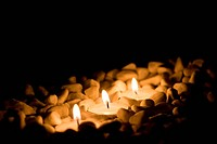 some candles with stones