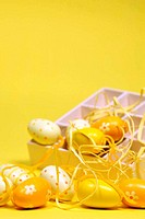 Yellow Easter eggs with a box