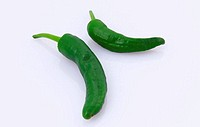Green peppers on white background