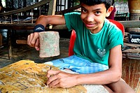 Young Cambodian student learning the art of leather craftsmanship, Siem Reap, Cambodia