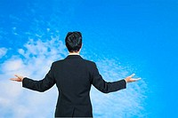 back view of businessman behind and presenting with blue sky