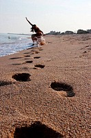 footprints in the sand left a girl