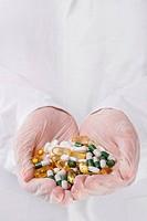 Doctor holding heap of pills