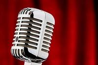 retro microphone against red velvet