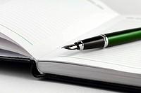 Green pen on notebook