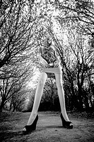 Shot of woman with long legs posing at alley