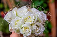 bouquet of artificial white roses with pearls