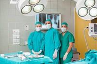 Serious medical team looking at camera