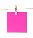 Pinned pink notepad isolated on white background