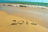 2012 new year message on the sand beach