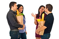 Two couples meeting at shopping for food