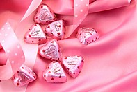 Valentine's chocolate hearts on pink satin