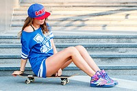 Outdoor, street. Attractive girl with skateboard