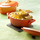 Small casserole dish of red mullet with root-celery and citrus fruit butter sauce