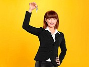 attractive, young businesswoman holding house keys