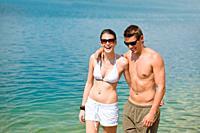 Couple in swimwear enjoy water and sun at sea