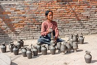 Bhaktapur, Nepal. Female Potter at Work in Potters´ Square.