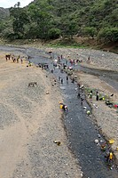 Africa, Ethiopia, Southern Ethopia, River scene seen from above with people taking a shower, taking water and making laundry in a small river between ...