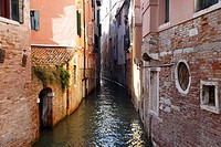 Decaying buildings down a narrow canal in Venice, Italy.