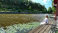 Woman sitting in the Porvoonjoki river in Porvoo, Finland.