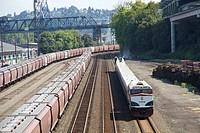 The Amtrak Cascade Talgo passenger train just west of downtown Tacoma, Washington, headed south toward Portland, Oregon, USA.