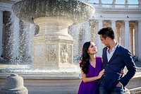 Couple in Piazza San Pietro with fountain. Rome. Italy.