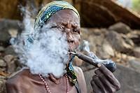 Koma women from the Atlantika mountains smoking the traditional pipe.