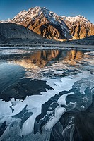 Mt Wakefield , ice bubbles and winter reflection in Mueller Lake, Aoraki / Mount Cook National Park, Canterbury, New Zealand.
