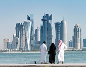 View along waterfront of Corniche towards modern office towers in West Bay financial and business district in Doha Qatar.