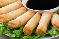 Traditional Chinese Spring Rolls with a dipping sause of soy sause.