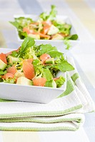 Salad of lettuce, avocado and smoked salmon.