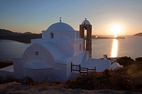 Domed church of Pangia Thalassitra overlooking the sea and the town Plaka at sunset, Milos, Cyclades Islands, Greek Islands, Greece, Europe.