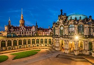 Bell Chime and entrance to the Procellain Collection at the Zwinger Palace at night, with the Dresden Castle in the background, Saxony, Germany. The C...