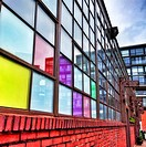 Warehouse with colorful windows converted into apartments in the gentrified Fishtown neighborhood of Philadelphia.