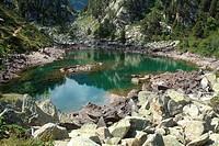 Small lake before ascending to lake Gerber. National Park Aigüestortes and lake San Mauricio. Lérida.