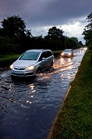 europe, UK, England, Surrey, flooded road.