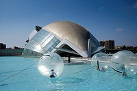 Children inside a water walking ball at the science park in front of the Hemisferic iMax building at Valencia.