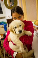 10 year old girl with Golden Retriever puppy
