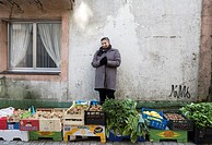 Melide market, in A Coruña. A woman sells the products of his garden in the street