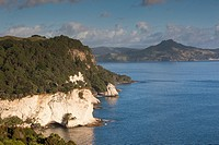 New Zealand, North Island, Coromandel Peninsula, Hahei, elevated view towards Cathedral Cove, morning.