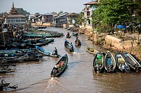 Traditional boats on canal heading to the Inle Lake, Nyaungshwe, Myanmar.