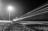 Train Passing by Langwies Station at Night in the Salzkammergut area, Ebensee, Austria