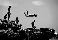 silhouettes of boys jumping into the sea, Castellon