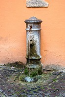 The current vintage outdoor drinking fountain, Old Roman ghetto, Italy, Europe.