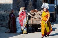Man selling cow dung fuel to women Junagadh Gujarat India.
