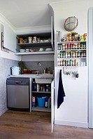 Part of a Kitchen with cupboard doors open in a home in the UK.