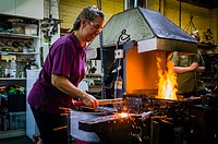 Lucille Scott (aka The Iron Maiden) working at her blacksmiths forge in the Eastney area of Portsmouth, Hampshire.