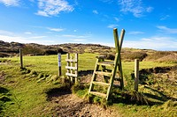 A stile over a fence into Braunton Burrows, Devon, England.
