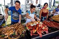 Florida, Miami Beach, Art Deco Weekend, community festival, fair, vendor, stall, street food, lobster, crab, sausage, Hispanic, man, woman, grill, foo...