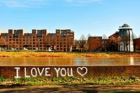 Maas River, Bonnefante Museum in Maastricht. With grafitti of 'I love you' written on the brick fence.